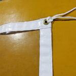 飛沫感染防止用テント横幕(3間・透明) 紐とハトメの様子